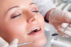 Closeup of a dentist hands about to do a procedure on a patient